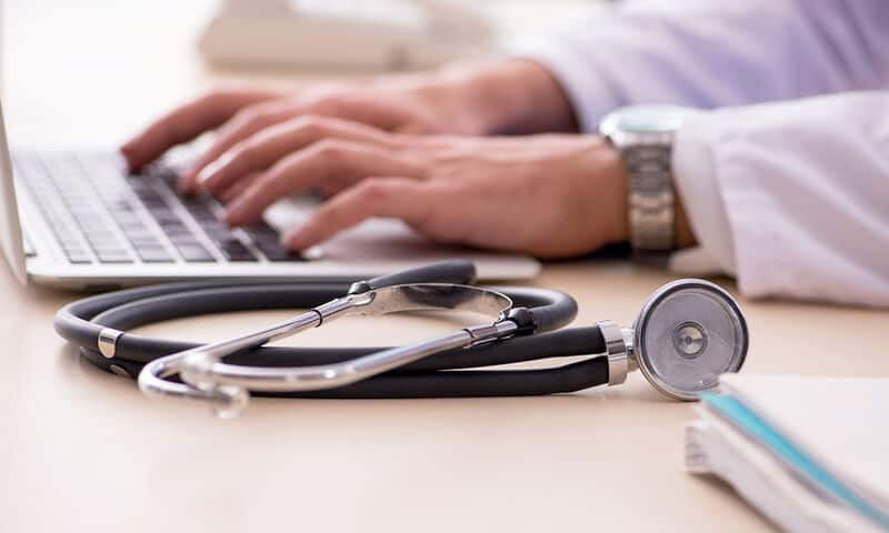 bigstock Young male doctor in telemedic 294148495